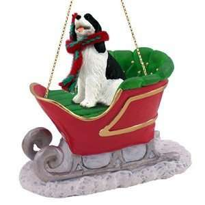 SPANIEL Dog Black/White on a SLEIGH RIDE Christmas Ornament NEW SLD22B